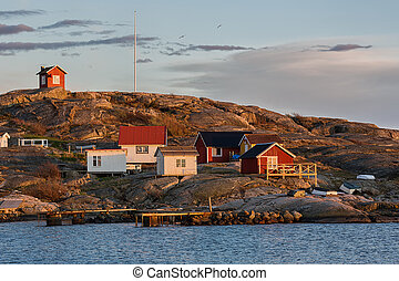 Fishing village in Sweden. - Cottages on island in...