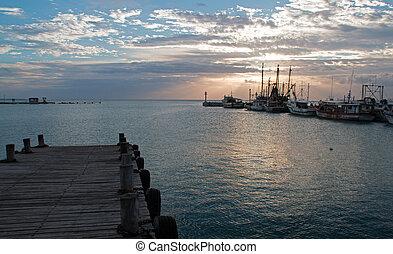 Sunrise over Puerto Juarez Boat Dock Pier Jetty Seawall in...