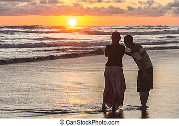 Couple watching sunset Indonesia