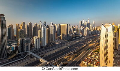 Beautiful aerial top view at sunset timelapse of Dubai Marina and JLT in Dubai, UAE