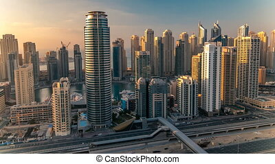 Beautiful aerial top view at sunset timelapse of Dubai...