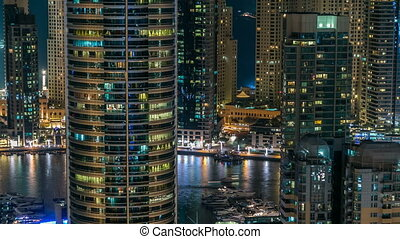 Beautiful aerial top view at night timelapse of Dubai Marina...