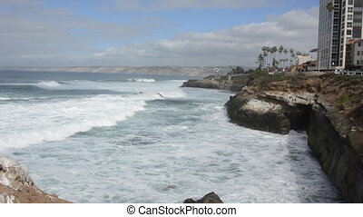 Waves Crash Against the Rocks in La Jolla, California near a...
