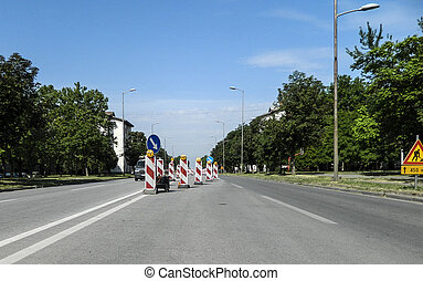 Road construction site - Traffic signs on the roadway in a...