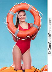 Lifeguard woman on duty with ring buoy lifebuoy - Joyful...
