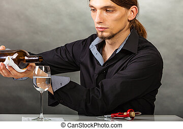 Wine steward fills glass. - Alcohol liquor drinking tasting...