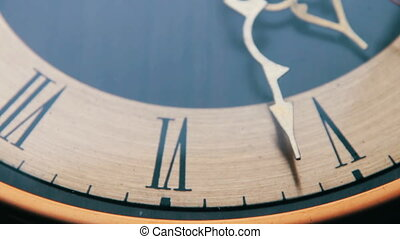 Vintage Analog Antique Clock with Arrows close-up ticking...