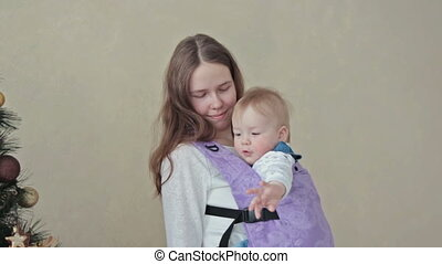 Mother holding baby in sling