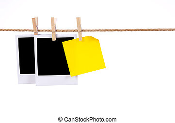 Blank photo prints and sticky note on a rope