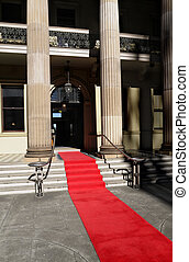 Red carpet laid in front of a luxury hotel building