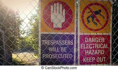 Warning Danger Signs On Fence - Signs warning no trespassing...