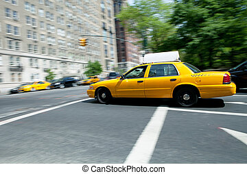 Speeding NYC Taxi - Yellow NYC taxi cab speeding by during...