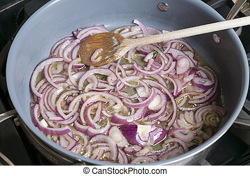 Sauteed onions - Sauteing red onions with oil in cooking pan...