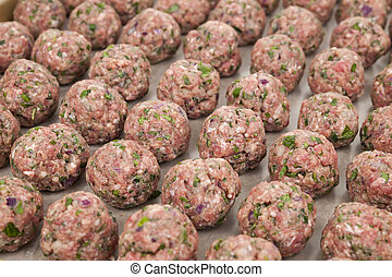 Raw meatballs - Rows of raw homemade meatballs prepared for...