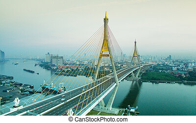 aerial view of bhumiphol bridge crossing chaopraya river...