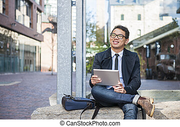 Young asian man with digital tablet - Young smiling asian...