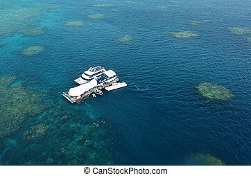 Aerial view of reef with marine diving platform and boats at the Great Barrier Reef