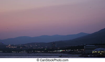 Sea Coast and Mountains after Sunset. Purple Sky - Sea Coast...