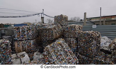 Piles Of Scrap Metal Bundled in Bales at Warehouse - Piles...