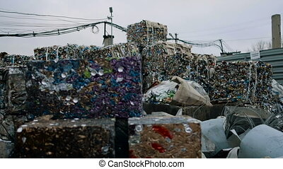 Piles Of Scrap Metal Bundled in Bales for Recycling. Metal...