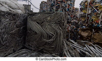 Piles Of Scrap Metal And Strip Bundled in Bales - Piles Of...