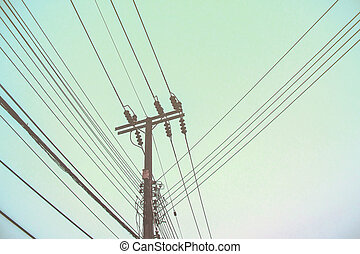Electricity poles witht the sky.