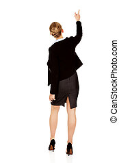 Back view of young business  woman pointing for somathing