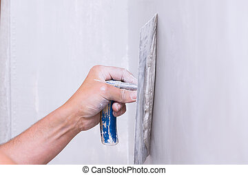 Professional skim coating - Handyman smoothing drywall...