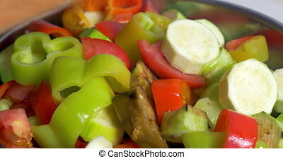 Adding cut vegetables in salad - Close-up of hand adding cut...