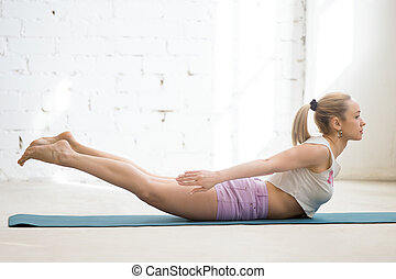 Backward extension exercise - Beautiful young woman wearing...