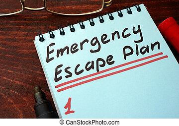Emergency Escape Plan written on a notepad with marker