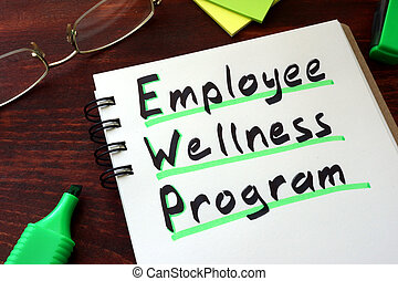 Employee Wellness program written on a notepad with marker.