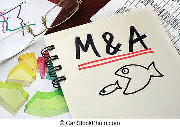 M&A Merger And Acquisitions written on a notepad with...
