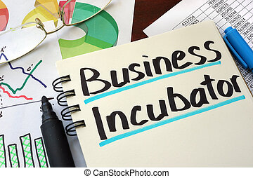 Business Incubator written on a notepad with marker