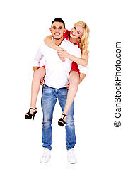 Young man giving piggyback to his girlfriend