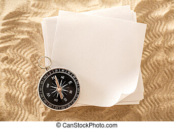 Blank sheets of paper with compass