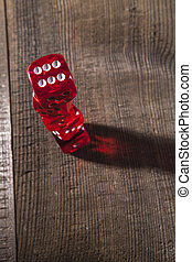 Dice and Dots - Red dice on a brown wood table