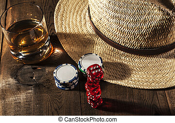 Alcohol and Dice - Alcohol and dice on brown wood table