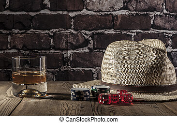 Dice of Luck - Hat, dice, chips and alcohol on wood table