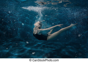 Woman dancing in the underwater. - Woman dancing under the...