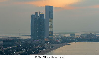 Top view of famous towers buildings in Abu Dhabi day to night timelapse.