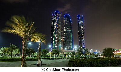 Famous towers buildings in Abu Dhabi night timelapse hyperlapse.