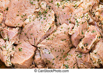 Fresh pork meat pieces in marinade