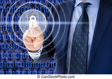 Cyber security concept - Businessman in a blue suit presses...