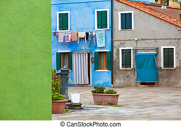 Colourfully painted house facade on Burano island, province...