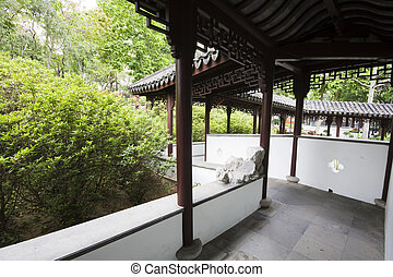 A wide chinese style garden with trees and plants