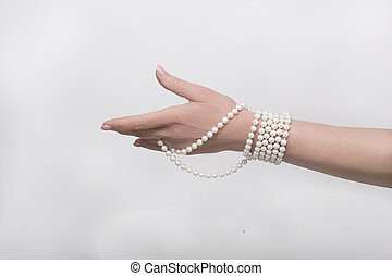 Beads on hand - Expensive beads are on womans hand isolated...