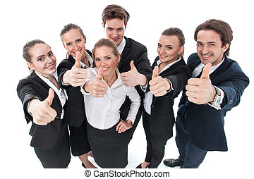 Business people showing thumbs up - Successful young...