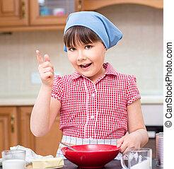 Girl is cooking in kitchen, indoor shoot