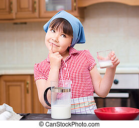 Girl is cooking in kitchen - Girl is cooking, thinking while...